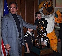 Head Coach Gary Pinkel showing off the Cotton Bowl Trophy