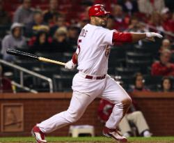 Pujols watches one of his four hits (Bill Greenblatt, UPI)