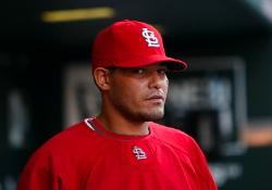 Molina watching from the dugout (Bill Greenblatt, UPI)