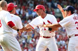 Ankiel mobbed by his teammates after game winner (Bill Greenblatt, UPI)