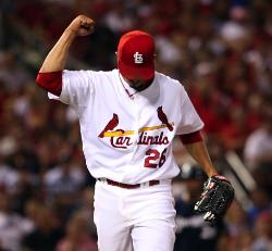 Kyle Lohse pumps his fist after getting out of the 7th, up 3-1 (Bill Greenblatt, UPI)