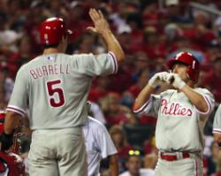 Shane Victorino greeted by Pat Burrell after his HR (Bill Greenblatt, UPI)