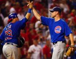 Geovany Soto congratulates Kerry Wood after getting Pujols to pop out (Bill Greenblatt, UPI)