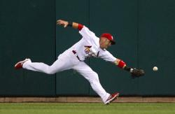 Skip Schumaker can't pull in a double, Bill Greenblatt, UPI
