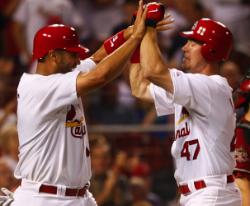 Ludwick congratulated by Pujols after his first inning homer (Bill Greenblatt, UPI)