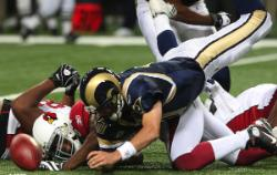 Marc Bugler fumbles in Rams' loss (Bill Greenblatt, UPI)
