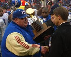 KU Coach Mark Mangino accepts Lamar Hunt Trophy