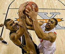 Keith Ramsey battles for a rebound (courtesy ostatephoto.com)