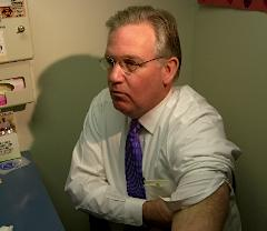Governor Nixon rolls up his sleeve for a flu shot