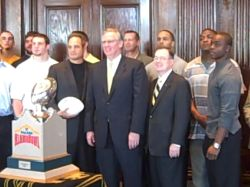 Gov. Nixon with Gary Pinkel and the MU football team