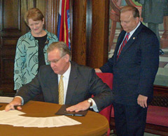 Governor Jay Nixon with Senators Joan Bray and Gary Nodler