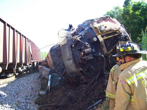 Crews work on the scene of a train collision