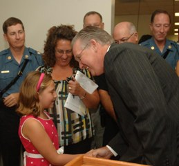 Gov. Nixon shakes Hope Turner's hand