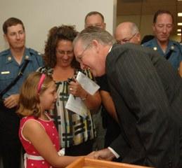 Gov. Nixon shakes Hope Turner's hand