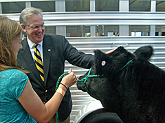 Governor Nixon with Dozer the steer and Claire Martin of Curryville