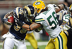 Green Bay linebacker Nick Barnett stops St. Louis running back Steven Jackson (UPI/Bill Greenblatt)