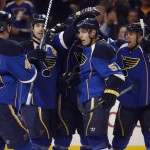 David Perron mobbed by teammates.  Bill Greenblatt UPI St. Louis