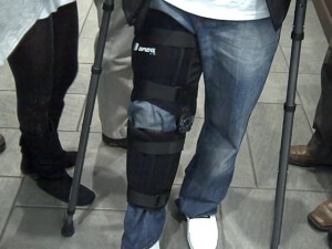 Jared Perry's knee braced up