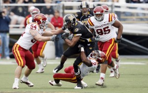 Iowa State defenders try to take down Missouri's Danario Alexander following pass reception (UPI/Bill Greenblatt)