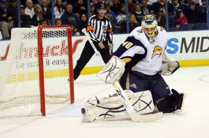 Buffalo's Patrick Lalime turns aside one of St. Louis' 35 shots.  Bill Greenblatt, UPI