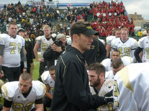 Lindenwood Head Coach Patrick Ross consoles players after loss in NAIA Championship Game