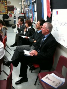 DESE's Stan Johnson (near) joins French delegation in Jefferson City High School French class