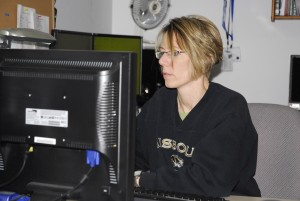 Detective Tracy Perkins scans the Internet for illegal activity, often tracking dozens of sites at the same time.