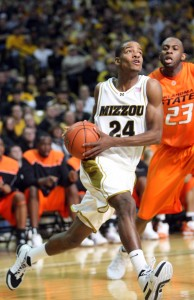 Missouri Tigers Kim English (15) moves past Oklahoma State Cowboys James Anderson for two points in the first half at the Mizzou Arena in Columbia, Missouri on January 30, 2010. UPI/BIll Greenblatt