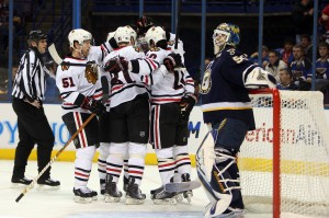 Chicago Blackhawks players celebrate a Patrick Sharp goal as St. Louis Blues goaltender Chris Mason regroups in the first period at the Scottrade Center in St. Louis on February 6, 2010.  UPI/Bill Greenblatt