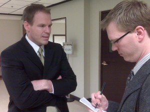 Scott Eckersley talks to a reporter after testifying before a House committee