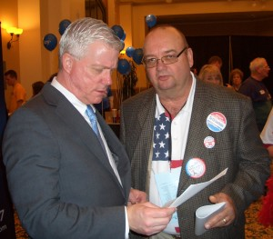 Lt. Gov. Peter Kinder talks with a supporter at Lincoln Days