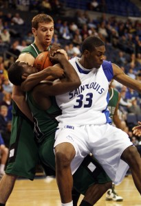 Saint Louis University Billikens Willie Reed (33) gets tangled up with Green Bay Phoenixs' Bryquis Perine Bill Greenblatt UPI St. Louis