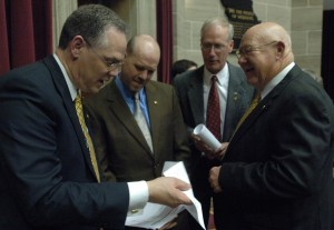 House Budget Committee Chairman Allen Icet huddles with state lawmakers during budget debate