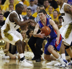 Kansas Jayhawks Tyrel Reed (R) slaps the basketball from the hands of Missouri Tigers J.T. Tiller during the second half at the Mizzou Arena in Columbia, Missouri on March 6, 2010. Kansas won the game 77-56.  UPI/Bill Greenblatt