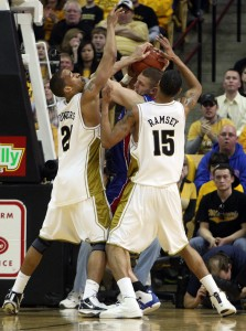 Missouri Tigers Laurence Bowers (L) and Keith Ramsey tie up Kansas Jayhawks Aldrich Cole during the first half.  UPI/Bill Greenblatt
