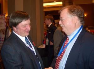 Sen. Chuck Purgason (left) talks to a participant at Lincoln Days