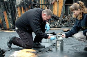 An investigator with the State Fire Marshall (left) works with a Federal Bureau of Alcohol, Tobacco, Firearms and Explosives to solve an arson case in Missouri. (Photo courtesy Dept. of Public Safety.)