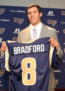 Quarterback Sam Bradford, holds up his jersey as he is introduced to reporters at Rams Park in Earth City UPI/Bill Greenblatt