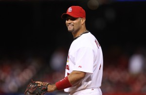 St. Louis Cardinals Albert Pujols laughs to teammates in the dugout as third baseman Felipe Lopez tries his hand at pitching to the New York Mets in the 18th inning.  UPI/Bill Greenblatt