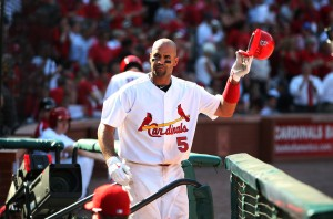 St. Louis Cardinals Albert Pujols tips his helmet after hitting a three-run home run in the third inning..     UPI/Bill