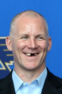 smiles during a press conference honoring Tkachuk for his years of service to hockey.  UPI/Bill Greenblatt