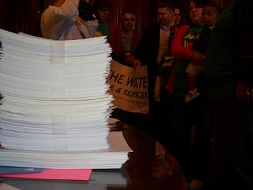 The AFSCME hand delivered 2,500 petition cards to the Governor's desk