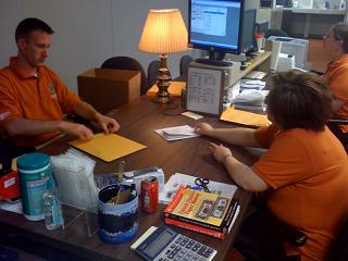 Treasurer's office employees search the contents of safe deposit boxes in the unclaimed property office