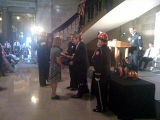 The family of firefighter David Grass of Odessa is recognized at the memorial service