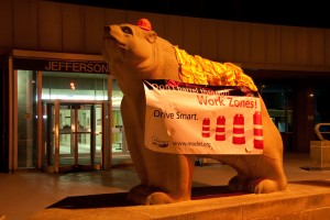 The Jefferson State Office Building bear in Jefferson City glows orange to raise awareness for work zone safety during Work Zone Safety Week, April 19 through 23. (Photo courtesy of MoDOT.)