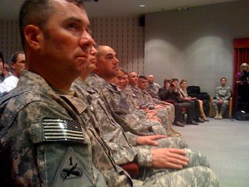 The ten Guardsmen returning home listen as Gov. Nixon addresses them