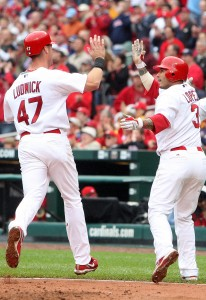 St. Louis Cardinals Felipe Lopez (3) greets Ryan Ludwick at home plate as the two score on a Matt Holliday double. UPI Photo/Bill Greenblatt