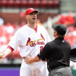 Chris Carpenter jaws with Carlos Lee, UPI, Bill Greenblatt
