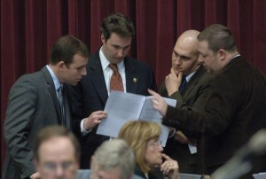 House Republican leaders review ethics bill during floor debate