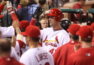 Ryan Ludwick is congrulated after his 8th inning home run. UPI/Bill Greenblatt